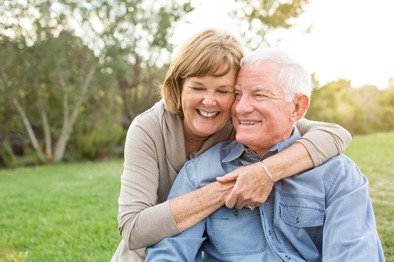 Testosterone Therapy Cost Per Month Mature Couple Hugging