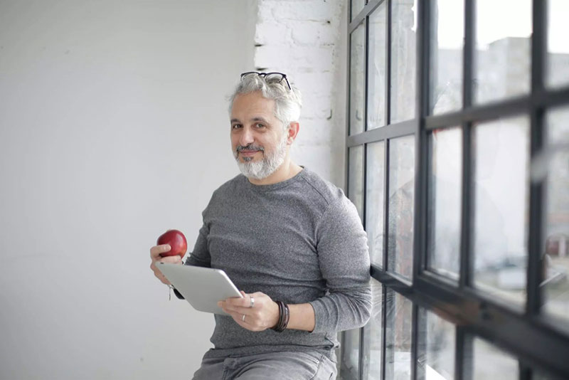 Testosterone Therapy Timeline Mature Man Eating Apple