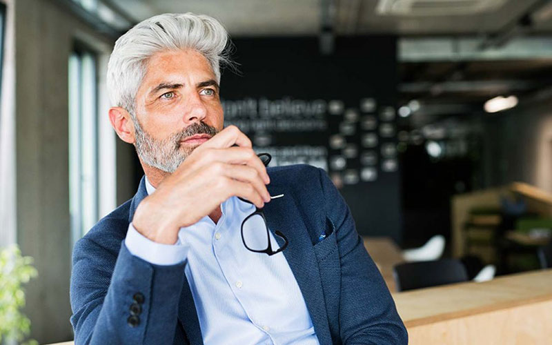 Is Testosterone Replacement Covered by Insurance-Grey Haired Thoughtful Man